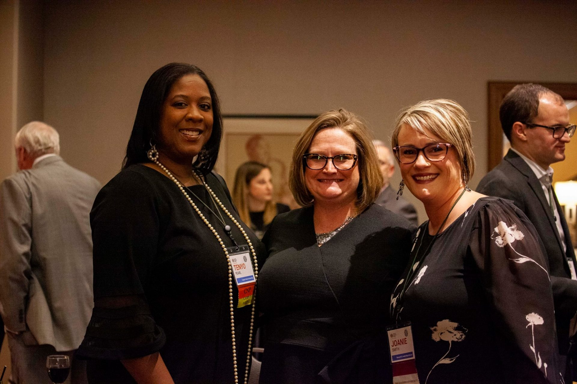 Image of three women at a Nonprofit Leadership Alliance event